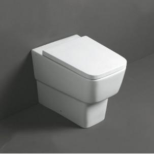 Degradé golvstående vägghängd toalett mot vägg eller golvavlopp